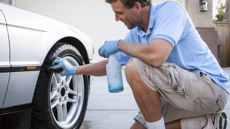 Mobile carwash, guy cleaning tires, residential