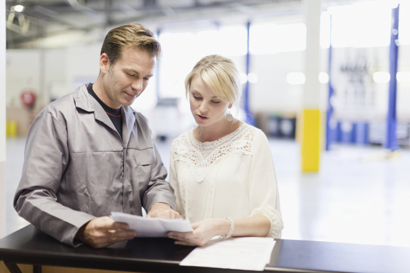mechanic talking to customer, car care, services, auto services, education