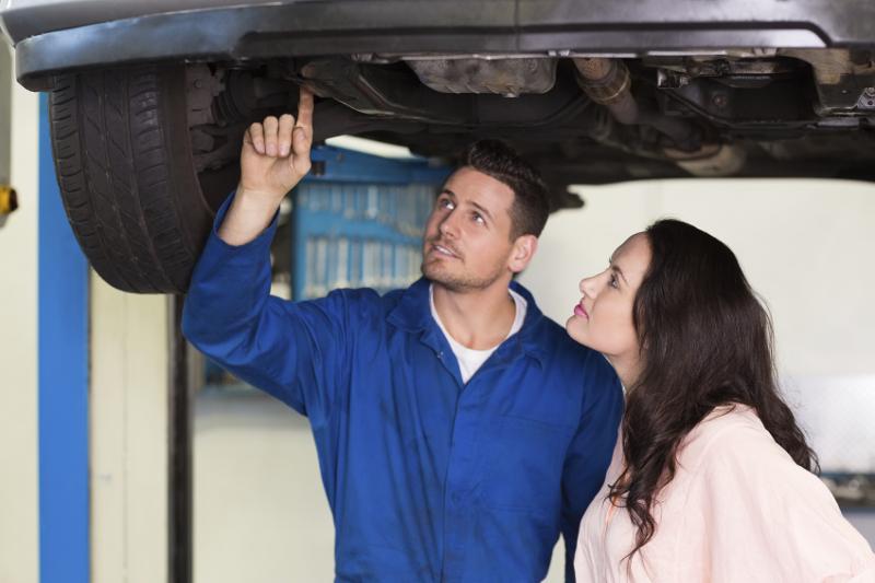 mechanic, services, rustproofing, customer, educating customer, showing customer, car care