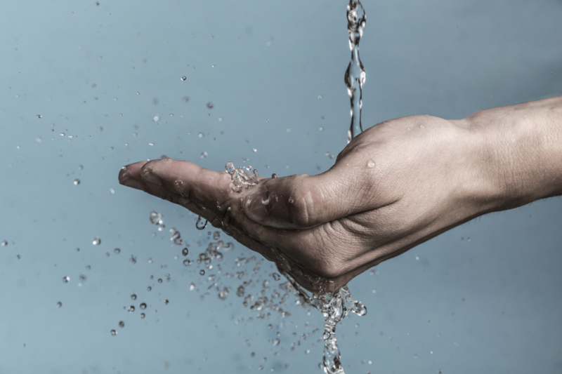 water dripping in hand, hand care, water, water conservation, sustainability, drops of water, environmental,