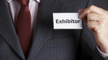Businessman Attaching Exhibitor Badge To Jacket, exhibitors, trade show, event, exhibit, exhibition, expo, tradeshow,