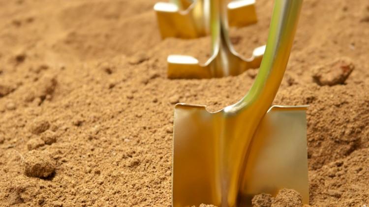 Breaking ground, ground, shovel, dirt, gold, gold shovel, grand opening, innovative.