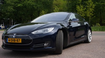 Tesla, sports car, black, driving, road, parked, battery-operated, wheels.