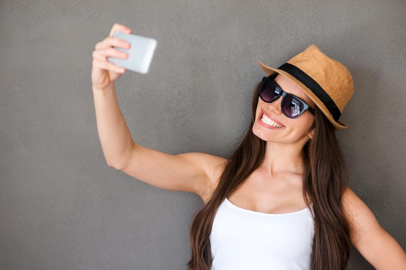Selfie, girl, hat, smiling, glasses, sunglasses, woman, studio.