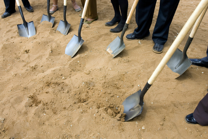 New location, grand opening, opening, breaking ground, ceremony, new business, shovel, dirt.