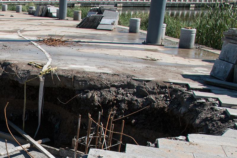 sinkhole, parking lot, road, sidewalk, dirt