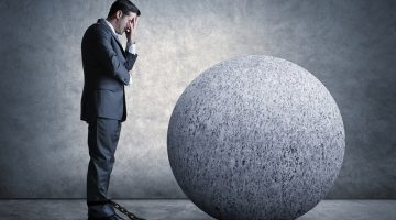 businessman, ball and chain, weight, held back, frustrated