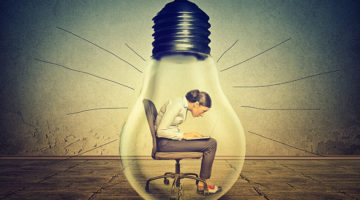 introverted entrepreneur, light bulb, ideas, laptop
