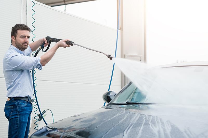 man, carwash, self-serve, self service bay, hose, nozzle, spray, car