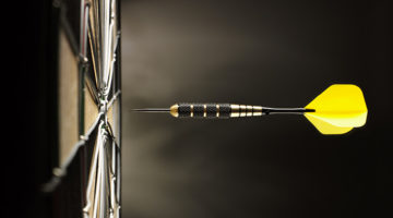 yellow dart, bullseye, dartboard