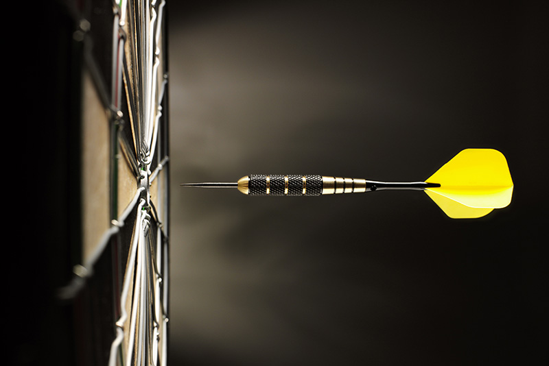 yellow dart, bullseye, dartboard