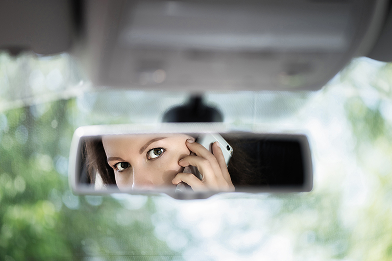 rear view mirror, woman, fear, cellphone, safety